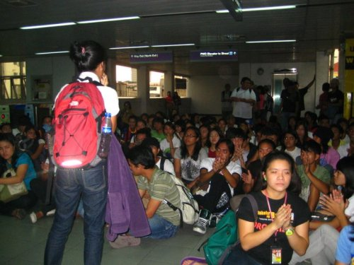 Jan. 14 - Youth activists stage a 'sit-down' protest at the LRT 2 Legarda station against the up-to 100% MRT-LRT fare hikes. Security guards and the station intercom where unable to drown out the protest and discourage the youths. Anti-fare hike groups like Anakbayan have vowed to mount more actions every Friday until the increases are junked.