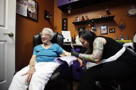 "fuckyeahgirlswithtattoos:  Mimi Rosenthal, 101, is all smiles while Michelle Gallo-Kohlas tattoos a sunflower on her arm at Requiem Body Art in Spring Hill Saturday. When Rosenthal turned 99, she decided to get her first tattoo, an ""itty-bitty butterfly"" on one of her ankles.   OMG. I LOVE THIS WOMAN."