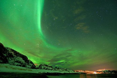Kryptonite Haze Photograph by Thilo BubekA streak of auroral light mimics the curve of an illuminated bridge near Sommarøya in northern Norway on January 7. The glowing display of curtains, arcs, and bands in the sky is called aurora borealis, or northern lights, in the Northern Hemisphere and aurora australis, or southern lights, in the Southern Hemisphere.