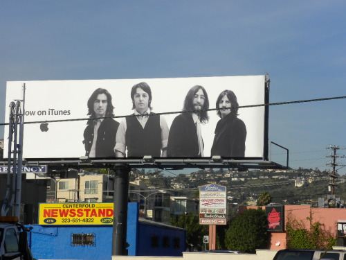 There's nothing like the billboards of L.A. The Beatles are thrown on modern streets and iTunes all at once.
