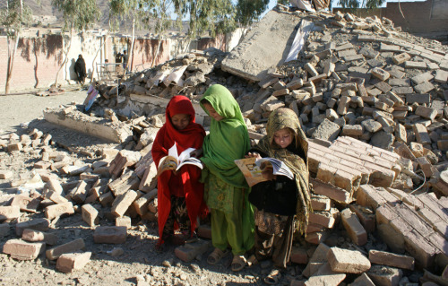 DEFIANCE: Pakistani girls collected their books from the debris of what used to be  their school near the Afghan border Monday after the Taliban allegedly  bombed the school. The militant group has bombed dozens of schools for  girls. (Photo: Said Nazir Afridi / EPA via the Wall St. Journal) (via inothernews) Follow us on Facebook | Twitter or Submit something or Just Ask!