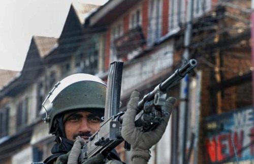 An Indian Central Reserve Police Force (CRPF) soldier looks on at Srinagar s central square Lal Chowk on January 25, 2011. The right-wing Bharatiya Janata Party (BJP) has organised a rally of youth members to Srinagar, the main city of Muslim-majority Kashmir, where they want to raise the national flag on Republic Day.The world in pictures: January 25, 2011.