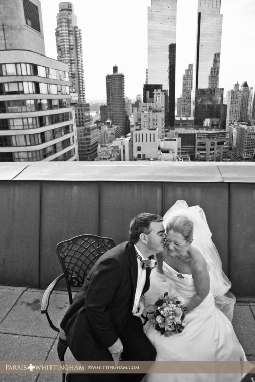 NEW YORK, NY — Molly and Sean slip away from their wedding guests and enjoy a quiet moment on the rooftop of New York Athletic Club. Their New York wedding celebration was especially meaningful because they chose to honor the lives of New Yorkers affected by the events of September 11th.  Read more of their New York wedding celebration.