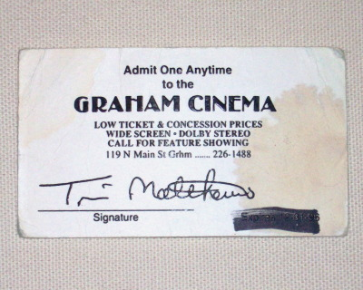"Acquired: 1997/1998 Charming in its own way, The Graham Cinema is one of the few old theaters I know of that hasn't been turned into a wedding venue or a restaurant (yet). But the real appeal of the place is the proprietor, Tim Bob, who uses the theater's information hotline to tell (often terrible, sometimes in poor taste) jokes in his heavy Carolina drawl. I used to keep this unused, un-expired (I think) free admission ticket in my wallet. When we first moved west, sometimes I'd call the Graham Cinema hotline just to hear a southern accent. Thrown away: 2011. I'm throwing this in the trash next week. Right now, it's in an envelope on my desk. Since the expiration date was crossed out, there's a decent chance this thing is still good. If you're in North Carolina and you want (maybe) free admission to a picture show at the Graham Cinema, use the ""ask"" button to contact me and this sucker's all yours. Hoarded for: 13-14 years. Pain at loss: None. I saved the number (area code 336) to my phone."