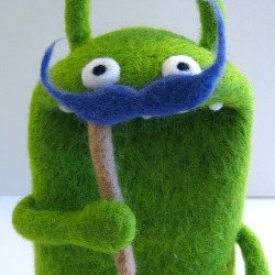 Apparently this is some amazing blue moustached ugly doll like creature by a person called Moxie. I LOVE THIS.
