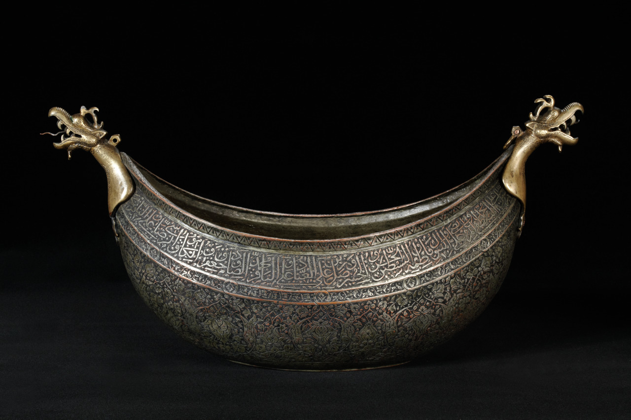 Kashkul (begging bowl), engraved, tinned copper (probably beaten), with points of cast brass Iran; 1st half of 16th century H: 25,5; L: 52; W: 20 cm            http://www.davidmus.dk/en/collections/islamic/dynasties/safavids