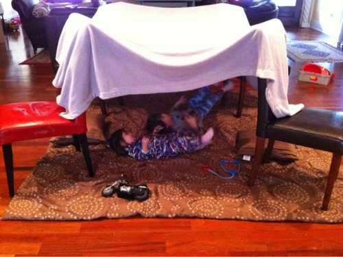 It's a cold and rainy day in Atlanta… Perfect for making a nice cozy fort. When I was a kid, I remember thinking how much I loved when my mom would make forts for us… The kids literally light up when they walk into a room that I've set up a tent. Our chairs are almost always out of place around here, but I'm sure they wouldn't want it any other way.