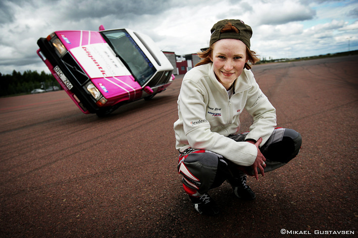From the archives  Stunt driver Erika Söderman shot for Aftonbladet. Erika is 17 years old and together with her father she has a 2-wheel stunt show. While we where shooting I asked her if it was difficult standing on the side of the car whilst it was on it's side. She didn't think so and asked if I wanted to try. Being me I'll never pass on the opportunity to do stupid things so………. and so.