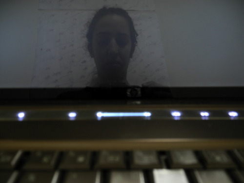 Self-portrait in laptop. I M ROBOT GHOST.