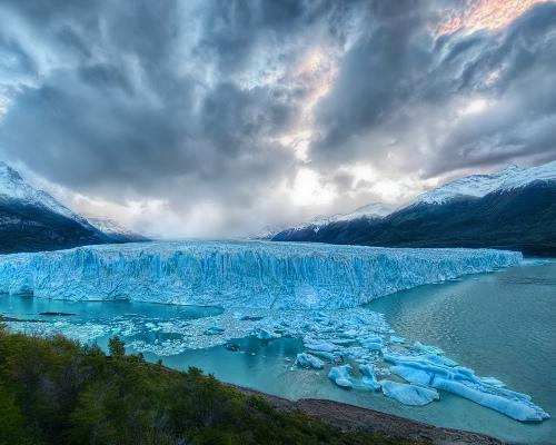 A land of untouched beauty, South America's Patagonia could be  dramatically altered by climate change. Many of its glaciers are  steadfastly retreating because of rising temperatures and declining  precipitation. While this land won't disappear entirely, its landscape  may soon be altered beyond recognition if global warming persists.