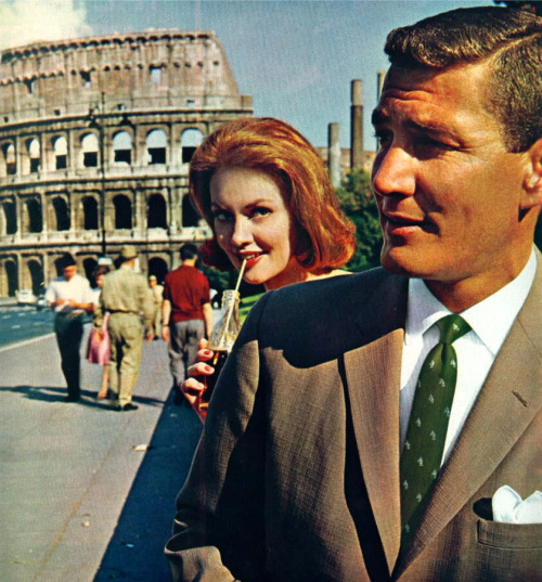 colosseum. red hair. green tie.