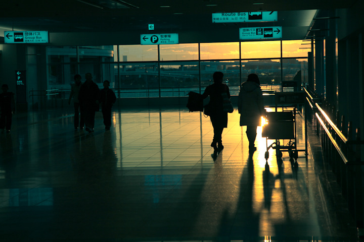 "PLACES OF JAPAN 04 - ""HANEDA AIRPORT AT SUNSET (2 of 4)""   As we were waiting for Vicki's dad to arrive at the airport I snapped a few shots while Vicki was… a) playing Super Mario Brothers 3 in a ""Video Armageddon"" tournament. Her opponent is a young Fred Savage. b) smoking cigarettes with a young Fred Savage. c) being questioned by the authorities for allowing a young Fred Savage to smoke cigarettes. d) checking her email in an internet cafe. Note: If this post makes no sense click here. It may help a bit although probably not."