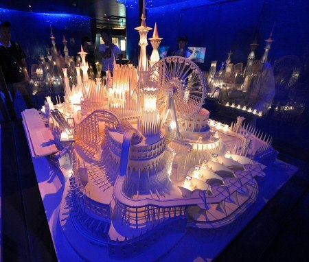 """A Castle On the Ocean"" by Wataru Itou. The installation is hand made over four years of hard work, complete  with electrical lights and a moving train, all made of paper!"