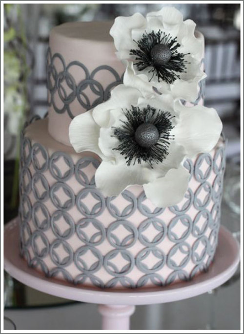 Pink gray and white wedding cake with anemone sugar flower cake topper