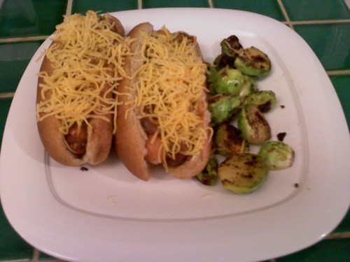 Dinner 1.27.11  My version of healthy chili dogs. They're made with whole wheat buns, turkey chili, fat free turkey hot dogs, and reduced fat cheddar cheese. Served with sautéed brussel sprouts.
