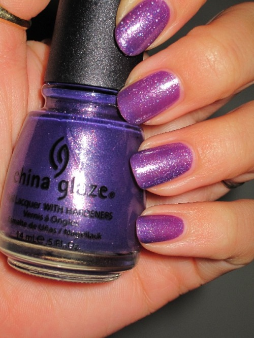 "China Glaze ""Grape Juice"" is an underrated color, I think. The microglitter (foil? shimmer? ultrashimmer? what is this?!?! help, bloggers!) in it is amazing.  Photo via Nailstah."