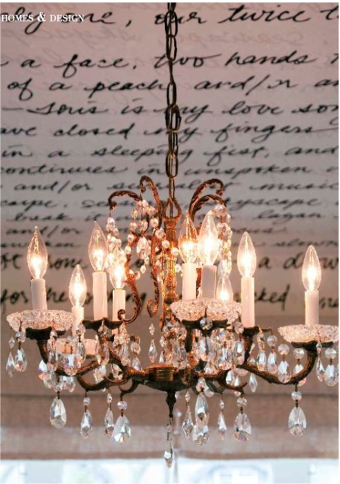 bellewest925:  A vintage chandelier illuminates a love poem writ large, chandelier in the bedroom is a salvaged 1930s piece, with gorgeous crystal.