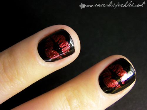 "Kiss mark manicure using Rimmel  ""Rock'n Red"" & Bundle Monster plate #2.  Via Emerald Sparkled."