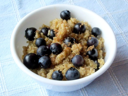 robotheartrecipes:  Breakfast Quinoa with BlueberriesMakes 2 cups After being rudely awakened early this morning by my cat and laying in bed for about an hour cursing my animal lover streak and my insomnia in equal parts, I decided to make the best of it and tear myself away from my cozy jersey sheets to make breakfast. Although this delicious little ditty was not originally vegan, since I do not drink dairy milk, I veganized it by using almond milk. It is totally simple and quick to make. If you enjoy quinoa in salads and as a side dish and such, give this a whirl—it makes a delicious breakfast too! INGREDIENTS 2 cups almond milk (or other dairy milk replacement) 1 cup quinoa, rinsed 3 tablespoons light-brown sugar, plus more for serving 1/8 teaspoon ground cinnamon, plus more for serving 1 cup (1/2 pint) fresh blueberries, plus more for serving INSTRUCTIONS Step One: Bring milk to a boil in a small saucepan. Add quinoa, and return to a boil. Reduce heat to low, and simmer, covered, until three-quarters of the milk has been absorbed, about 15 minutes. Step Two: Stir in sugar and cinnamon. Cook, covered, until almost all the milk has been absorbed, about 8 minutes. Stir in blueberries, and cook for 30 seconds. Serve with additional milk, sugar, cinnamon, and blueberries. Source: Martha Stewart Living, February 2010. View the recipe on MarthaStewart.com.
