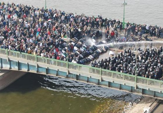 theatlantic:  soupsoup:  Police shoot high powered water at peaceful praying protesters. (via @zeenat)  Simply incredible.