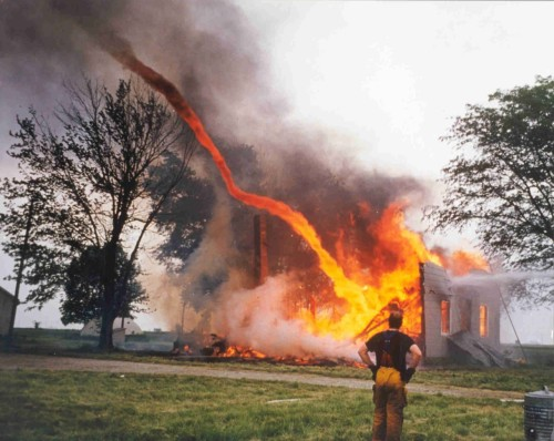 satanismus:  Fire from a burning building being sucked into a tornado.