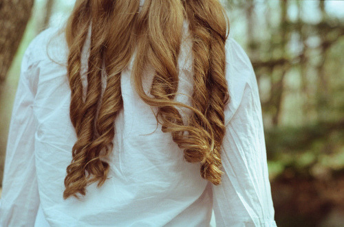 Honey blonde curly hair