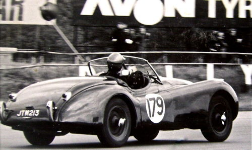 Jaguar XK120 (1949) racing at Silverstone.