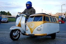Two things I love…scoots & VW buses (three thins if you count sidecars). soillfollowthesun:  So awesome