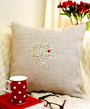laurenludlow:  crumpledenvelope:  sewing button heart pattern cushion :: Craft :: All About You   Love this craft idea!
