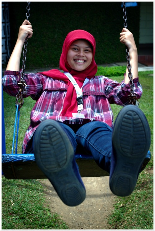 swing swing there is this short swing in bumi sangkuriang, and we (me and @darldarlene vitri) just happen to be wandering off in the playground after some incomprehensible (to our mind - or at least mine) talk at wordcampid 2011. She was afraid at first, so i have to make an example to go first and make sure that the swing was safe. And at last as you can see i the picture that she was enjoying her time with the swing.