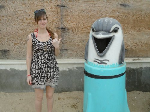heythisisit:  creepiest trash cans in the world   Cut out the middle man. Throw your trash directly into a dolphin's mouth.
