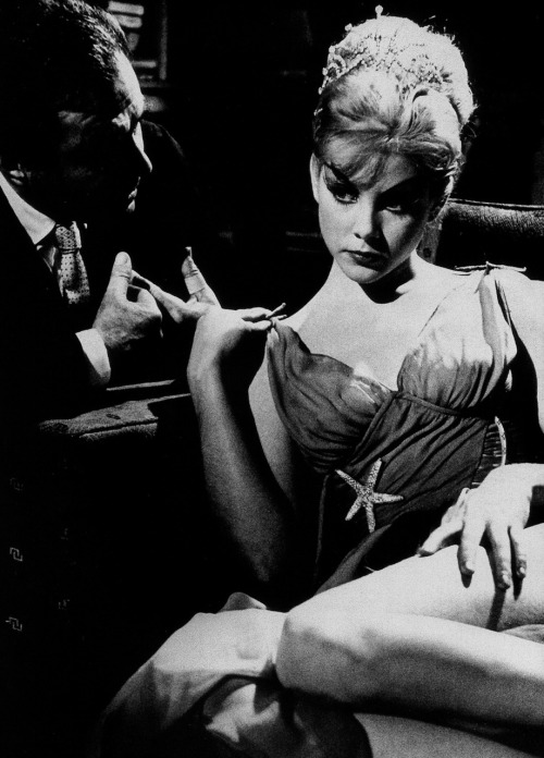 James Mason & Sue Lyon in Lolita (1962, dir. Stanley Kubrick) Q. In your last genuinely contemporary film, Lolita, you were  frustrated in your efforts to make the movie as erotic as the novel, and  there was some criticism that the girl was too old to play the nymphet  of the novel.  Kubrick: She was actually just the right age. Lolita  was twelve and a half in the book; Sue Lyon was thirteen. I think some  people had a mental picture of a nine-year-old. I would fault myself in  one area of the film, however; because of all the pressure over the  Production Code and the Catholic Legion of Decency at the time, I  believe I didn't sufficiently dramatize the erotic aspect of Humbert's  relationship with Lolita, and because his sexual obsession was only  barely hinted at, many people guessed too quickly that Humbert was in  love with Lolita. Whereas in the novel this comes as a discovery at the end, when she  is no longer a nymphet but a dowdy, pregnant suburban housewife; and  it's this encounter, and his sudden realization of his love, that is one  of the most poignant elements of the story. If I could do the film over  again, I would have stressed the erotic component of their relationship  with the same weight Nabokov did. But that is the only major area where  I believe the film is susceptible to valid criticism. -excerpted from The Film Director as Superstar by Joseph Gelmis