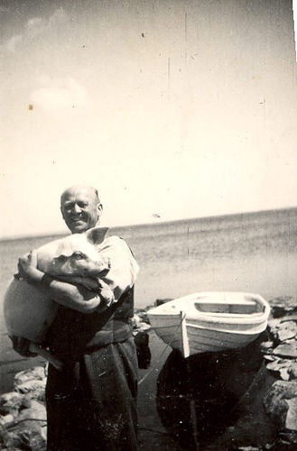 "1941 ""This is my Swedish grandfather with Josefine the pig.  He died before I  was born but apparently was a remarkable man, stong as an ox. He  emigrated to the USA in about 1900 to Marquette, Michigan but eventually  returned to Sweden.  That's the Baltic sea in the background."" (via Paul Jackson)"