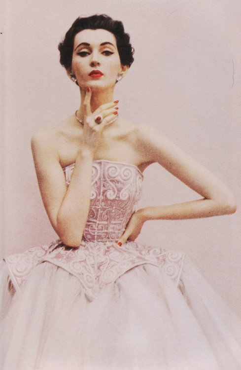 theniftyfifties:  Model in a Balenciaga evening gown.  Photo by Richard Avedon for Harper's Bazaar UK, 1950.   Balenciaga + Richard Avedon + 1950s = pure love.