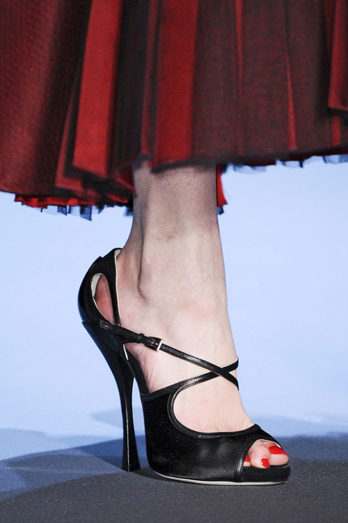 Bright red toes at Christian Dior. Via