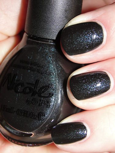 "Nicole by OPI ""Drama In The Dark"". Via I found the pic on eBay, but the watermark says Pretty Polish. I did a Google search and nothing! Does anyone know where the Pretty Polish blog/Flickr is?"