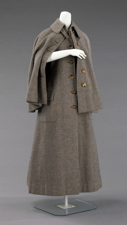 Sporting Coat | c. 1885 This overcoat, which does not follow the bustle silhouette of the period, would have been worn for sporting activities where the popular bustle style would have been difficult to wear, such as shooting and hiking. It is well-made and presents standard construction details which are still in use on the modern overcoat.