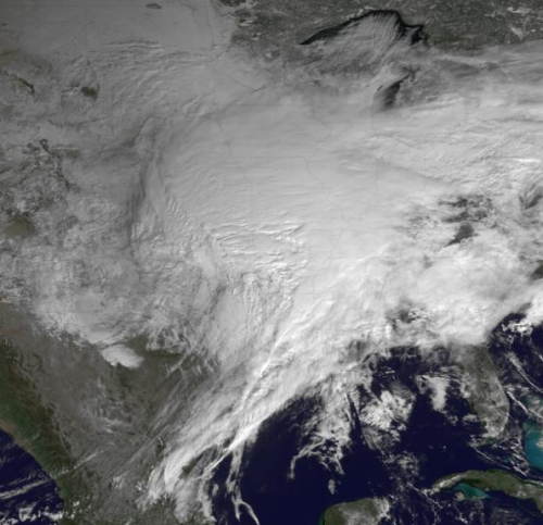 A storm cloud is covering nearly the entire U.S. this morning. Meanwhile Down Under, Aussies brace for a cyclone. Oddly enough, Punxsutawney Phil poked his head out and didn't see his shadow this morning, meaning we're getting an early spring? Hard to believe right now. image via