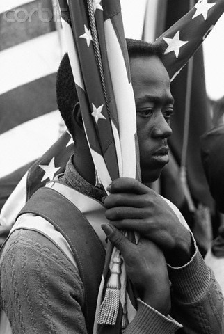 afro-art-chick:  Man Holding American Flag During Selma Civil Rights March  A young man holds the American flag during the Selma to Montgomery Civil Rights March. IMAGE:© Steve Schapiro/Corbis