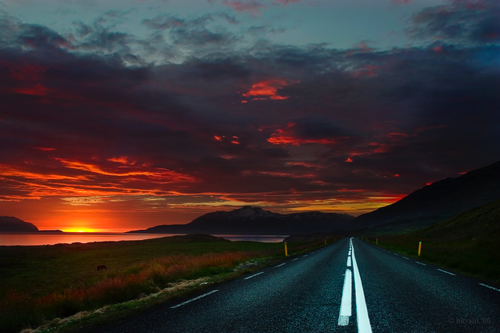 Driving into the long lasting Icelandic sunset.
