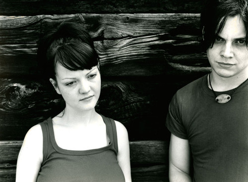 "allysong:    The White Stripes photographed by Ewen Spencer in 2001. Photography Director Marian Paterson recalls: ""This shoot was taken in Bristol when they were tearing up the UK touring tiny venues, driving themselves in their beaten up old van nicknamed The Magoo. At this time we all believed Jack when he claimed Meg was his little sister!"" Photo: Ewen Spencer/NME"