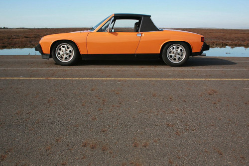 1974 Porsche 914 2.0L  I will never own a Porsche 914.  I must keep telling myself this. Davey G picked up a 914 a few months back and I've been hearing tell of how awesome it is just about ever since.  I will never own a Porsche 914.  I've no patience, and in truth, barely enough skill, for replacing fuel pumps, re-installing jacking points and chasing down sneak currents. And I live in a country where the number of worthy, and indeed unworthy, 914s can probably be counted on, if not one, then both hands.  I must resist the stern modernist lines. I must resist the gloriously optimistic 1970s German palette. The minimalism so severe as to make an MX-5 seem Baroque.  I will never own a Porsche 914.  /via Clemson on flickr. You should check out the whole 106-image set.