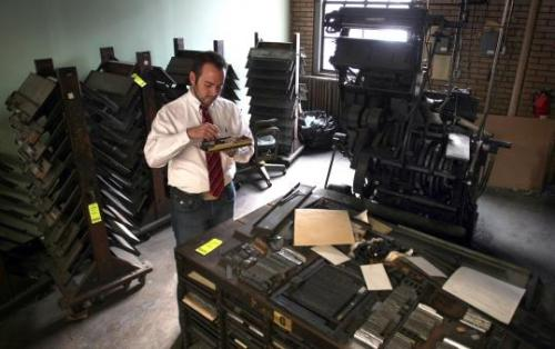 ifiwereahoarder:  Contents of old North End printing plant up for auction - The Boston Globe:  Row after row of creaky oak drawers hold thousands of letters, both metal type and wooden blocks, from fine print to 72-point Tudor. A cigar box brims with square block stamps of the city seal. And there are metal etchings of a few of the city's forefathers, presumably used years ago to print their faces on official documents.  If I were a hoarder (and had money) I would definitely bid on square block stamps of the city seal and maybe also the linotype machines and letter presses… (via housingworksbookstore)  wow, i'd love to get on top of this :D