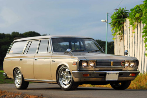 "Toyota Crown Wagon, ""Moon Equipped""  Moon: noun 1. the natural satellite of the earth, visible (chiefly at night) by reflected light from the sun.  verb 1. behave or move in a listless and aimless manner 2. [informal] expose one's buttocks to (someone) in order to insult or amuse them  Sounds about right.  /via Moon"