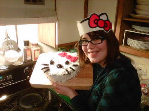 Me and my birthday cake that James baked me! It's hello kitty! It's so cute. The cake was chocolate with a raspberry middle. He baked two full cakes before constructing this one, there was sooo much cake left over to just munch on! BEST BIRTHDAY CAKE EVER.
