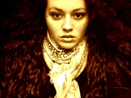[Image: sepia-tone photo of a woman in a scarf and with lots of shiny hair spread around her.] Genevieve from NY <3