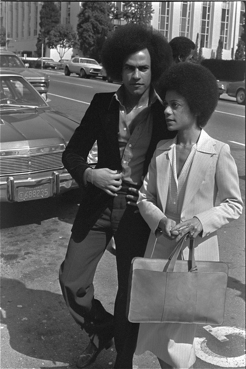 """If you stop struggling, then you stop life."" - Huey Newton, shown with wife, Gwen Fountaine, arriving at the Alameda County Courthouse in Oakland, California."