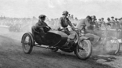 Get your butt into that sidecar, boy. Let the lady drive.