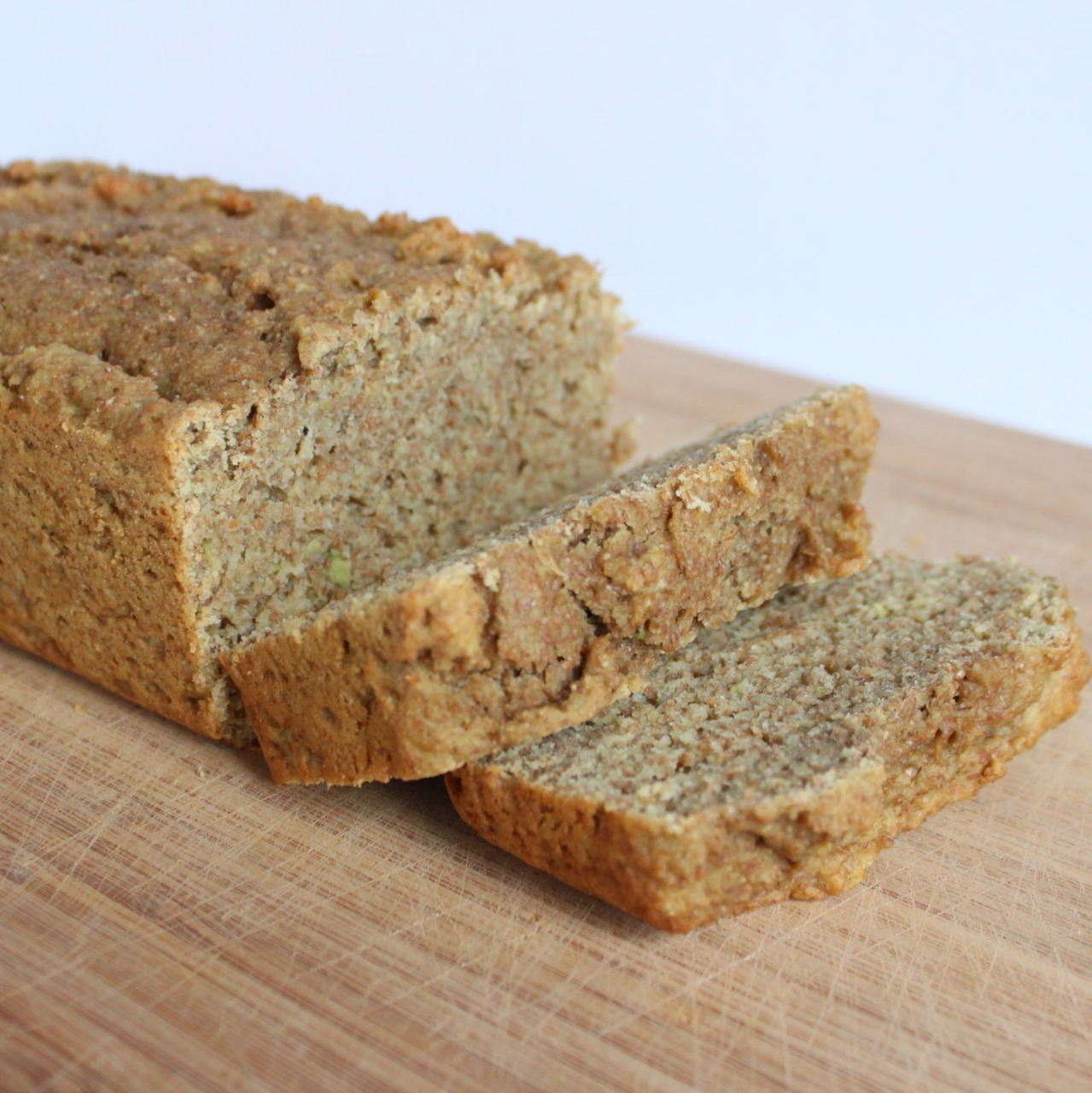 Avocado Wheat Bread 2 cups whole-wheat flour 1/2 cup granulated sugar substitute (splenda) 3/4 tsp baking soda 1/2 tsp salt 2 medium ripe avocados, pitted and mashed  2/3 cup plain greek yogurt 2 eggs 2 tbsp extra-virgin olive oil 1 tsp vanilla extract Preheat oven to 350 degrees. Lightly grease bottom and sides of a 9x13 loaf pan. In a medium bowl combine flour, sugar, baking soda, and salt; whisk till combined. In a large mixing bowl, combine avocados, yogurt, eggs, olive oil, and vanilla; beat on low till well combined. Slowly add-in dry ingredients to avocado mixture beating only till combined. Spoon batter into prepared pan and even out the top. Bake for 40 minutes or until a toothpick entered in center of bread comes out clean. Cool bread in pan for 5 minutes, then cool completely on metal rack. Ahh I must make this soon! I need to get wheat flour. Here's the link where I found this recipe: http://www.squirrelbakes.com/2011/02/avocado-wheat-bread.html There was no calorie info so I drafted something up myself using the individual ingredients. I also researched to see if calorie content changes, raw vs. cooked, and for the most part NO unless you're cooking something like meat in which the fat will physically be melted off the meat. For the bread, everything in is everything you eat. You can read this great forum here if you're interested in understanding the chemistry behind this: http://boards.straightdope.com/sdmb/archive/index.php/t-551691.html Calorie Calculation (whole loaf): 2 cups whole wheat flour:      520 cals, 36 cals from fat, 4 g fat, 104 g carbs, 16 g fiber, 5 g protein 1/2 cup sugar (I'm not      using splenda): 387 cals, 0 cals from fat, 100 g carbs, 0 g protein 3/4 tsp baking soda: 0      cals 1/2 tsp salt: 0 cals 2 medium avocados: 578      cals, 480 cals from fat, 70.8 g fat, 29.8 g carbs, 23.6 g fiber, 9 g      protein 2/3 cup non plain greek      yogurt Chobani: 90 cals, 6 g carbs, 16 g protein 2 large whole eggs: 144      cals, 96 cals from fat, 10 g fat, 0.8 g carbs, 12.6 g protein 2 tbsp extra virgin olive      oil: 240 cals, 240 cals from fat, 28 g fat 1 tsp vanilla extract: 37      cals, 0 cals from fat, 1.6 g carbs, 0 g protein  Looks great! At 100 cals a piece, I get 2 g of fiber and 2 g of protein. Not bad, not bad. I would like more fiber and protein though. I could add whey protein but the cals would go significantly up. Oh I know, just put non fat cottage cheese on top!