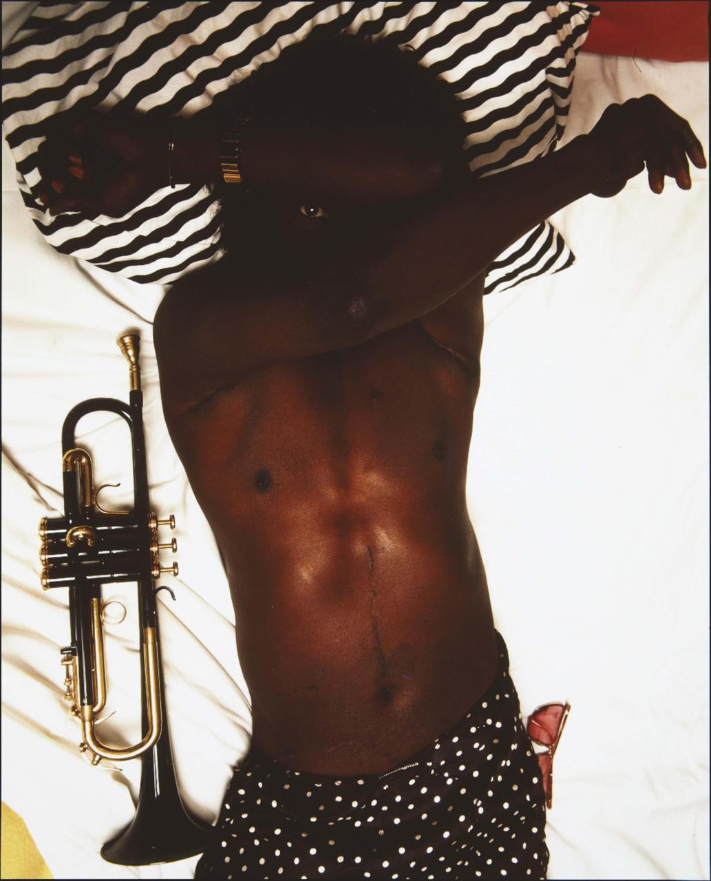 Miles Davis by Annie Leibovitz. …Miles had me wanting a black (…or red….or blue…) lacquered trumpet when I was younger.  Maybe one day.